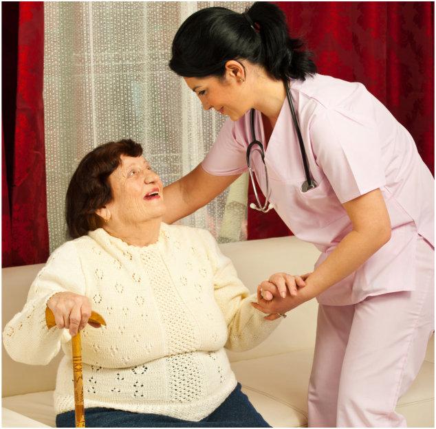 Caregiver assisting elder woman