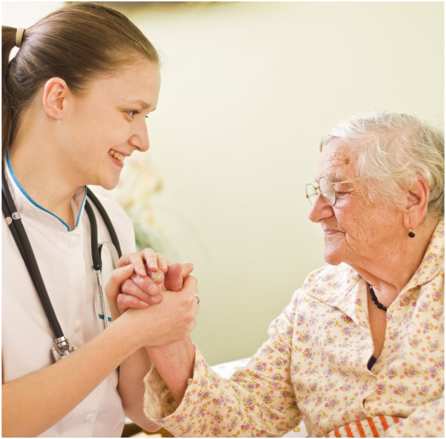 Caregiver and senior woman smiling to one another