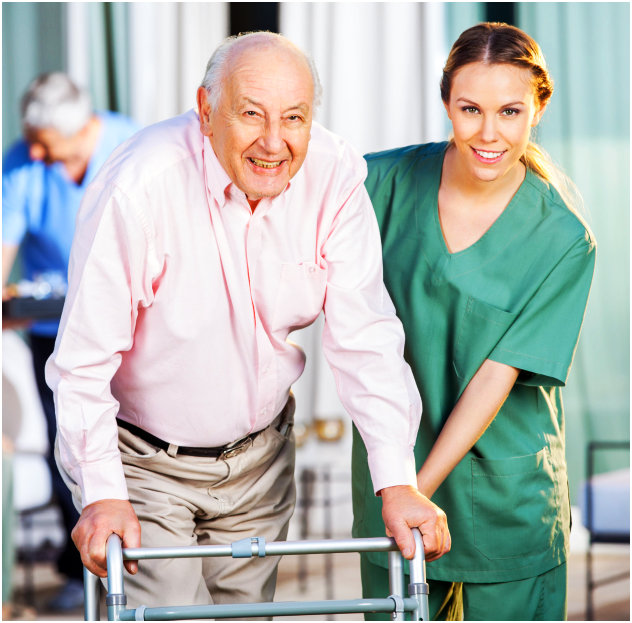 Elder man and female caregiver smilng