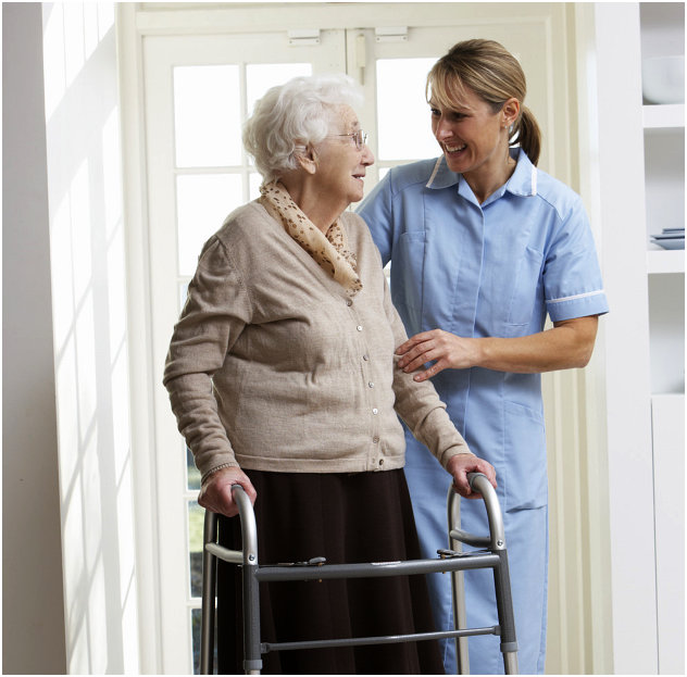 Elder woman and caregiver smiling to one another