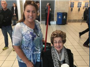 Senior woman accompanied by a woman
