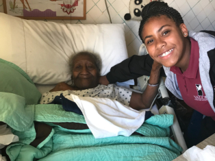 Senior woman in  bed at the hospital with her daughter