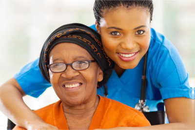 senior disabled women and her caregiver