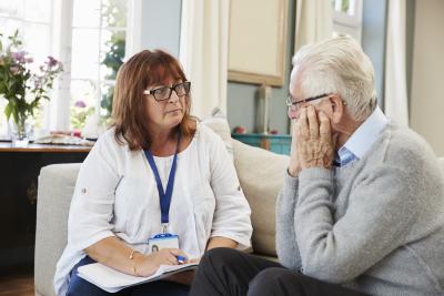 female consulting a senior man